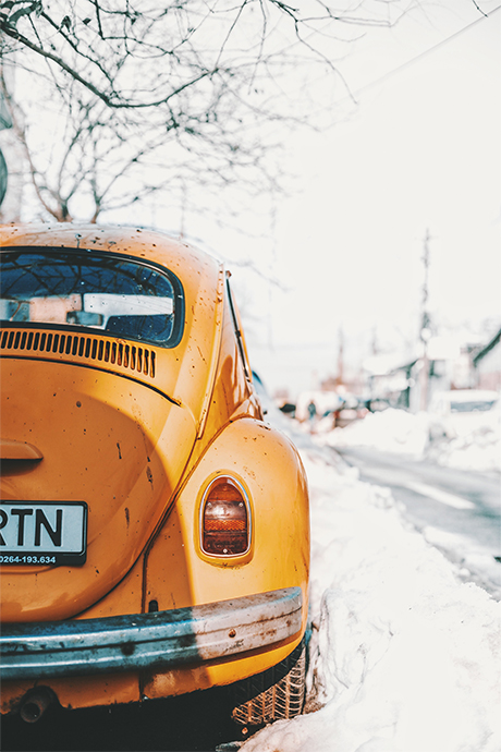An orange New Beetle during winter by Mihail Macri